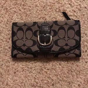 Gray and black coach wallet